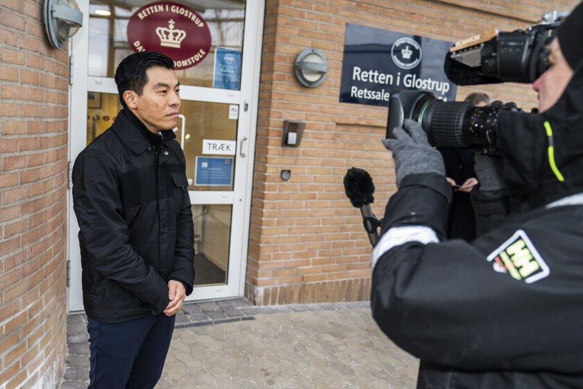 Senior prosecutor Rasmus Kim Petersen talks to the media prior to the trial of convicted murderer Peter Madsen arrives at the court in Glostrup, Copenhagen, Denmark, Tuesday Feb. 9, 2021. A Danish man convicted of torturing and murdering a Swedish journalist on his homemade submarine, was Tuesday, Feb. 9, 2021 sentenced to 19 months for his attempt to escape from a suburban Copenhagen prison last year during which he threatened prison staff and police with a fake gun and fake explosives. Peter Madsen was quickly apprehended on Oct. 20 outside the prison where he is serving a life sentence for the killing of Kim Wall. The conviction will not be added to the life sentence. However, it may play a role if Madsen who said he wanted to flee because of the prison conditions, at some point makes a probation request. (Martin Sylvest/Ritzau Scanpix via AP)