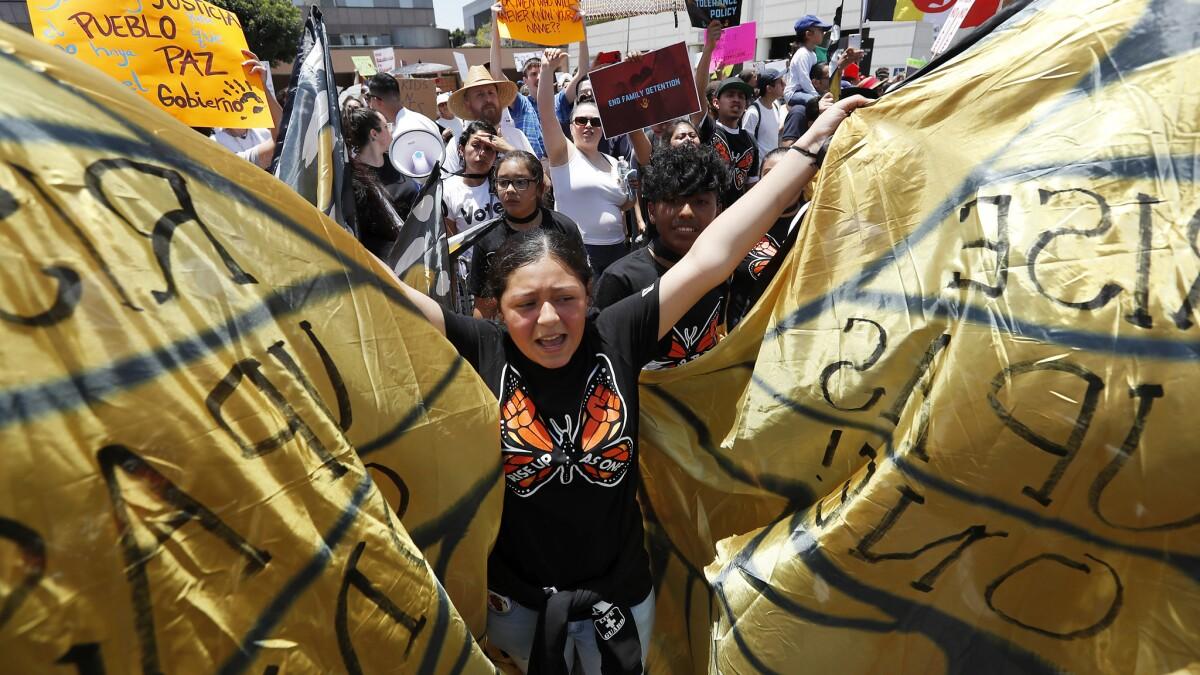 LOS ANGELES, CALIF. - APR. 30, 2018. Immigrants rights demonstrators march down Alamaeda Street in