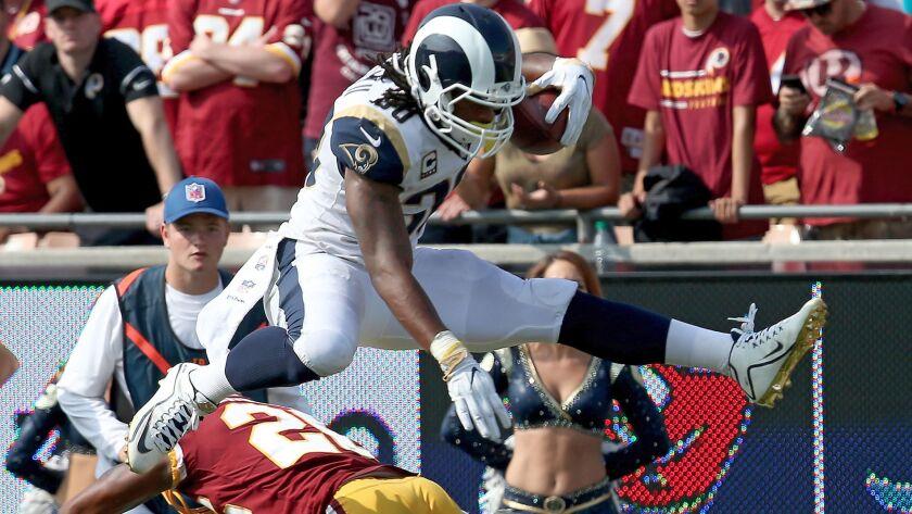 LOS ANGELES, CALIF. - SEP. 17, 2017. Rams running back Todd Gurley II hurdles over Redskins corner
