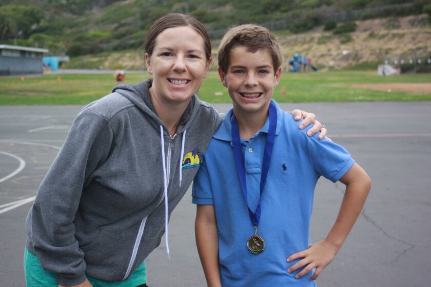 La Jolla Elementary Physical Education coach Kelly Wiskus with La Jolla Elementary top overall runner, fifth-grader Wil Buckley