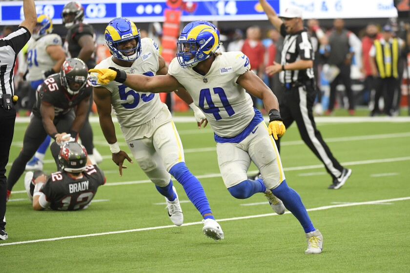 Los Angeles Rams inside linebacker Kenny Young (41) celebrates after sacking Tampa Bay Buccaneers quarterback Tom Brady during the second half of an NFL football game Sunday, Sept. 26, 2021, in Inglewood, Calif. (AP Photo/Kevork Djansezian)