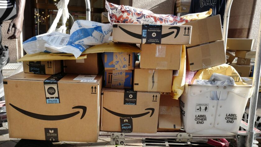 Amazon Prime boxes are loaded on a cart for delivery, Oct. 10, 2018 in New York. (AP Photo/Mark Lenn