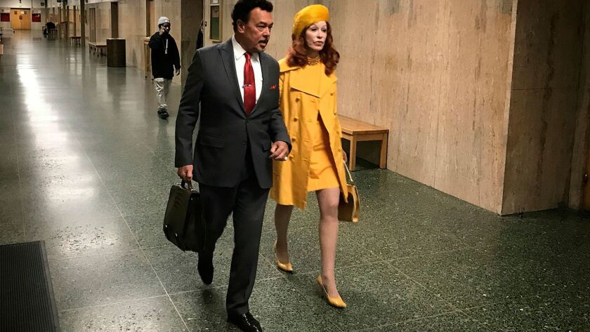 Cicely Ann Hansen, right, walks with her attorney Bill Fazio outside court in San Francisco on Monday. Hansen, the owner of a vintage clothing store, pleaded no contest to misdemeanor charges of selling coats and other items made of cheetahs, leopards and other protected species.