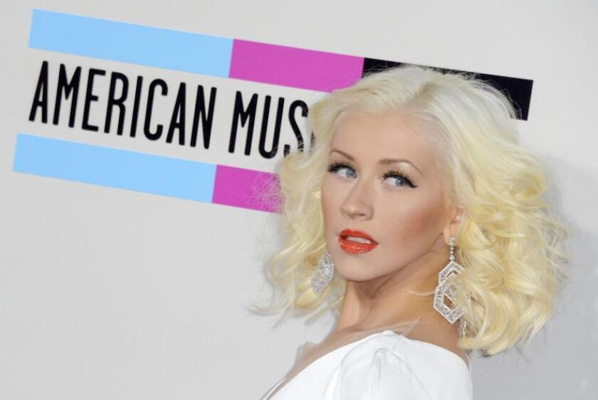 US musician and singer Christina Aguilera arrives for the 41st American Music Awards held at the Nokia Theatre in Los Angeles, California, USA. EFE/EPA/Paul Buck/File
