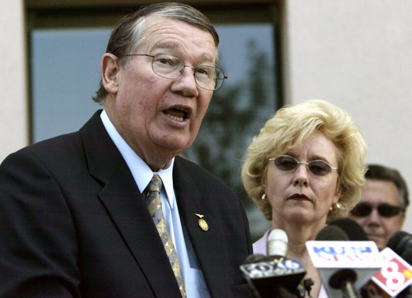 """This July 2005 file photo shows former Republican U.S. Rep. Randy """"Duke"""" Cunningham, flanked by his wife Nancy"""