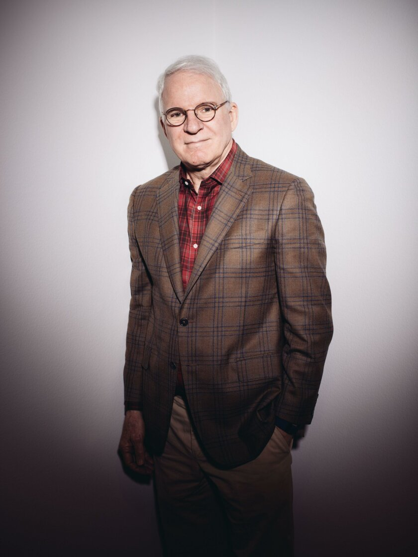 """In this Wednesday, Oct. 7, 2015,  photo, curator and actor-comedian Steve Martin poses for a portrait in a gallery for the exhibit """"The Idea of North: The Paintings of Lawren Harris"""" at The Hammer Museum in Los Angeles. (Photo by Casey Curry/Invision/AP)"""