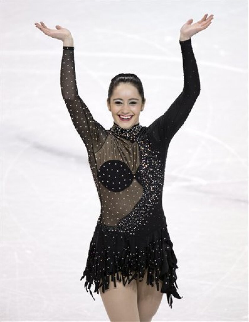 Kaetlyn Osmond of Canada, celebrates after performing in the ladies short program at the World Figure Skating Championships Thursday, March 14, 2013, in London, Ontario. (AP Photo/The Canadian Press, Frank Gunn)
