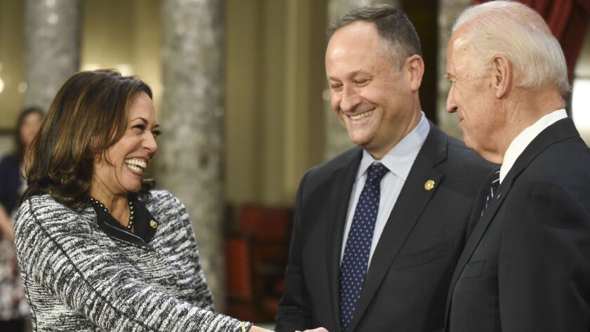 Kamala Harris, with husband Douglas Emhoff, greets then-Vice President Joe Biden in January 2017.