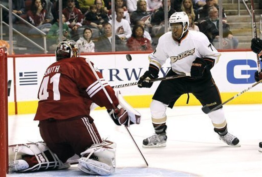 Phoenix Coyotes goalie Mike Smith (41) makes a save on a shot as Anaheim Ducks' Devante Smith-Pelly watches the rebounded puck go into the air during the first period in an NHL hockey game, Saturday, March 31, 2012, in Glendale, Ariz. (AP Photo/Ross D. Franklin)