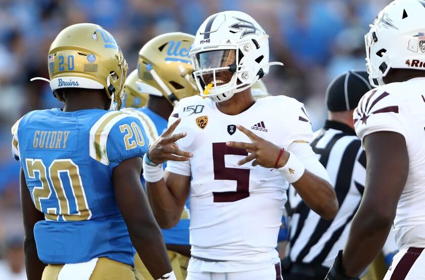 Arizona State quarterback Jayden Daniels celebrates after scoring a touchdown against UCLA last month.