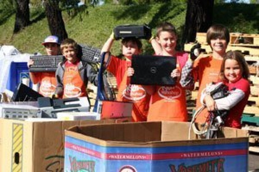 Helping to recycle e-waste are Kids Korps members: (L-R) Trevor Thiele, Soren Mosher, Caden Moss, Jonathon Neuberg, Slade Mosher and Sophia Mosher.