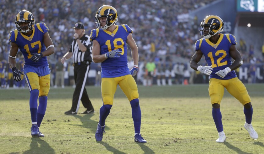 Los Angeles Rams wide receiver Robert Woods (17), wide receiver Cooper Kupp (18) and wide receiver Brandin Cooks (12) line up at the line of scrimmage during the second half in an NFL football game against the Seattle Seahawks Sunday, Nov. 11, 2018, in Los Angeles.