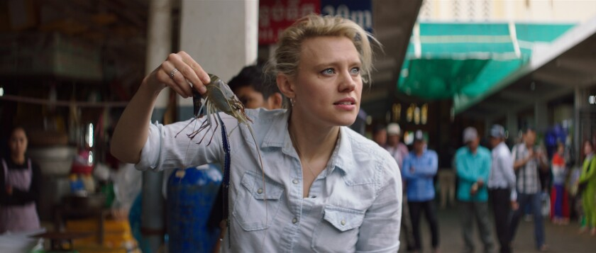 Kate McKinnon handles a live prawn from a street vendor in Phnom Penh, Cambodia.