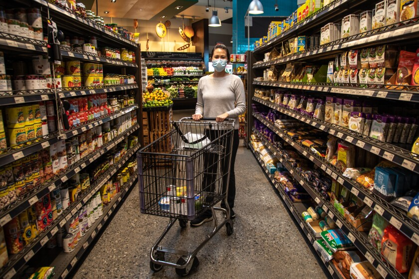 SAN DIEGO, CA - NOVEMBER 19: Stephanie Nguyen goes food shopping ahead of the Thanksgiving holiday at Baron's Market in North Park on Thursday, Nov. 19, 2020 in San Diego, CA. (Jarrod Valliere / The San Diego Union-Tribune)