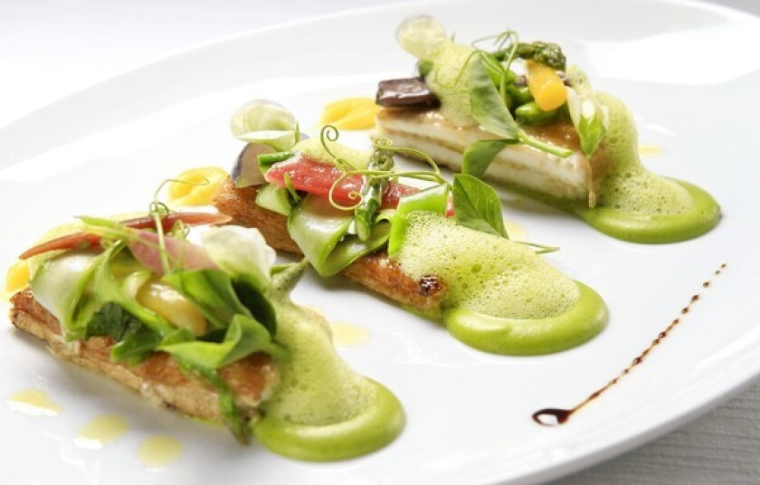 Sauteed dover sole with sugar snap peas, torpedo onions, asparagus, Ligurian olive oil and a garlic emulsion.