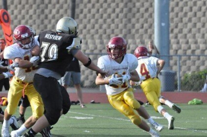 Torrey Pines' Sully O'Brien ran for one TD and received another TD. Photo byClaudia Perrone
