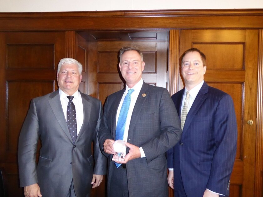 Congressman Scott Peters (center) receives the 2016 BIO Legislator of the Year Award. Joe Panetta (left), president and CEO of Biocom, and Todd Gillenwater, (right) executive vice president of CLSA, are pictured with Representative Peters.