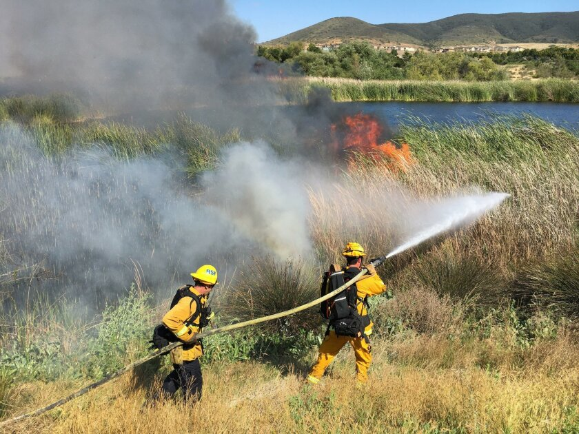 Fire crews battled a 5-acre vegetation blaze in 4S Ranch Thursday afternoon. Don Boomer