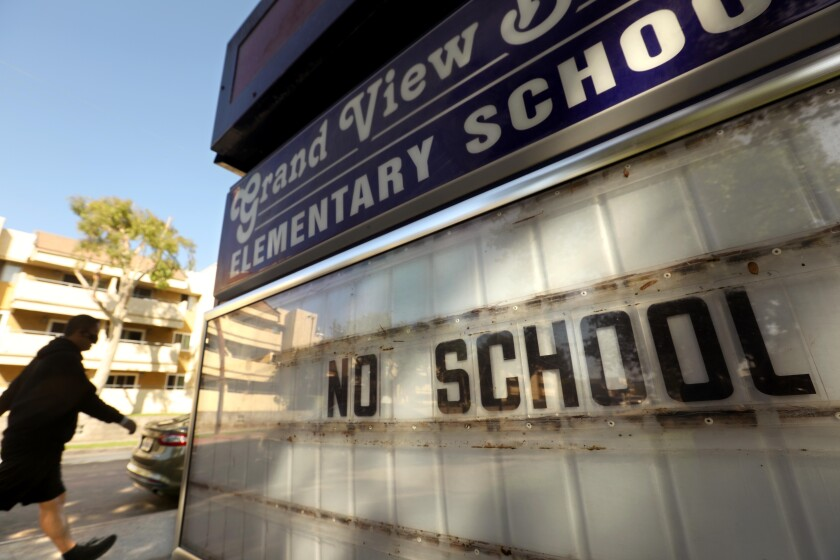"A sign outside a Mar Vista elementary school reads ""No school"""
