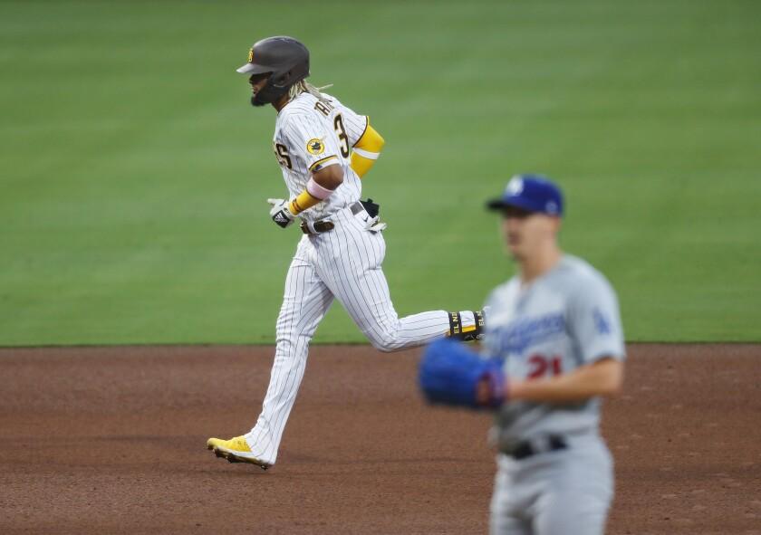 Fernando Tatis Jr. rounds the bases after hitting a solo homer off Dodgers pitcher Walker Buehler on August 3 at Petco Park.