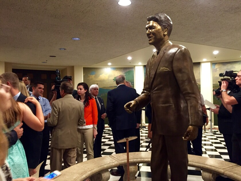 An 8-foot tall, 800-pound bronze statue of Ronald Reagan, the former California governor and U.S. president, is unveiled in the California Capitol on Monday.