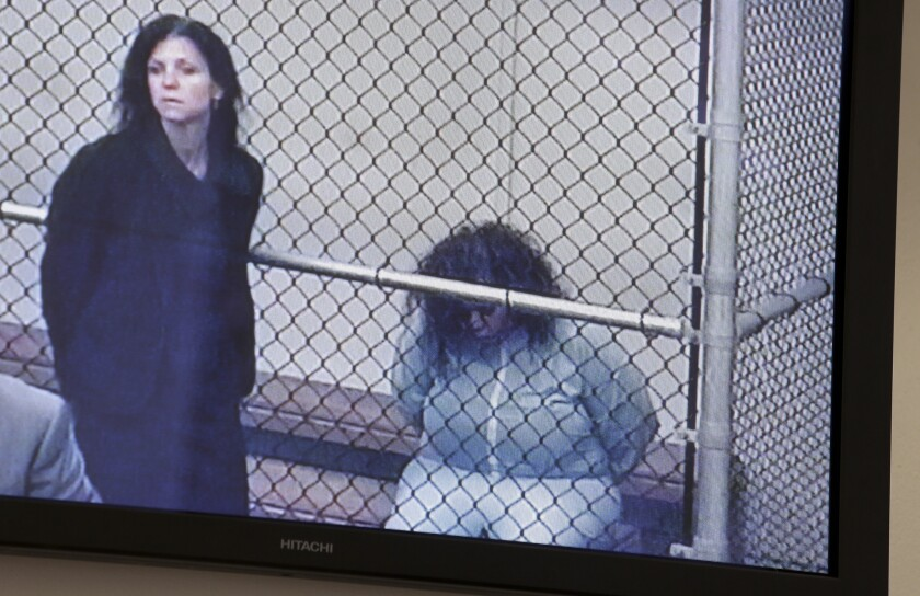 Marilyn Kay Edge, right, appears on a monitor with Orange County deputy public defender Arlene Speiser at a video arraignment in Santa Ana in September 2013.