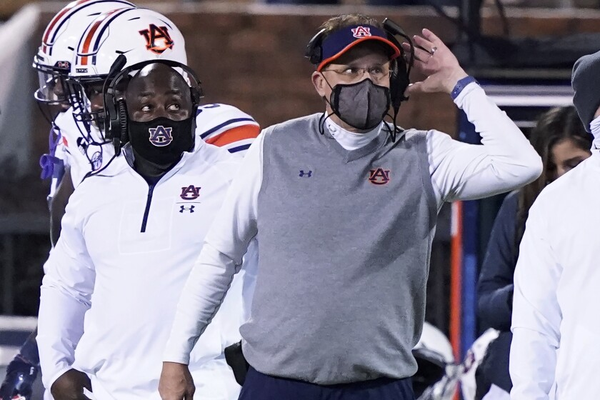 Auburn head coach Gus Malzahn listens to an official's call during the second half of the team's NCAA college football game against Mississippi State, Saturday, Dec. 12, 2020, in Starkville, Miss. Auburn won 24-10. (AP Photo/Rogelio V. Solis)