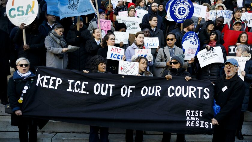 Protesters rally in 2017 against ICE arrests at courthouses
