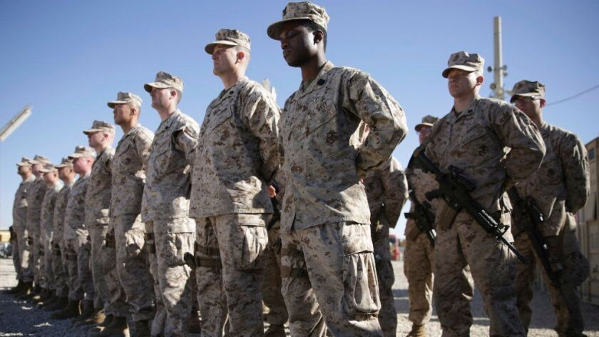 U.S. Marines stand at attention in January during the change of command ceremony in Shorab military camp in Afghanistan's Helmand province.