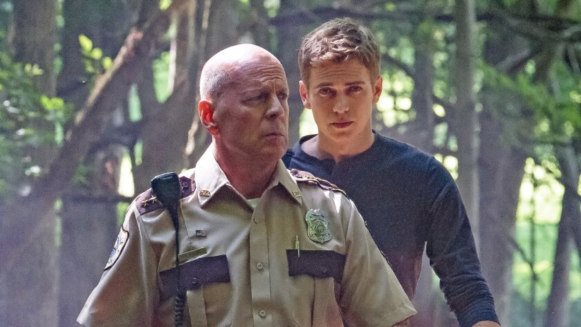 "Bruce Willis as Howell and Hayden Christensen as Will in the film ""First Kill."" Credit: Brian Dougla"