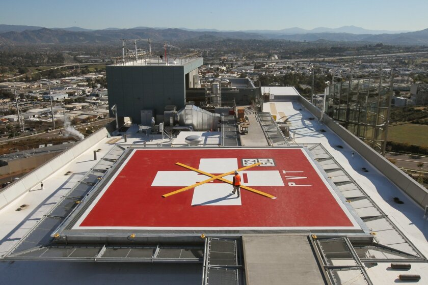 A view of the rooftop helicopter pad at Palomar Medical Center West, a $956 million, 11-story hospital being built in Escondido that is due to begin accepting its first patints in the fall. CHARLIE NEUMAN • U-T