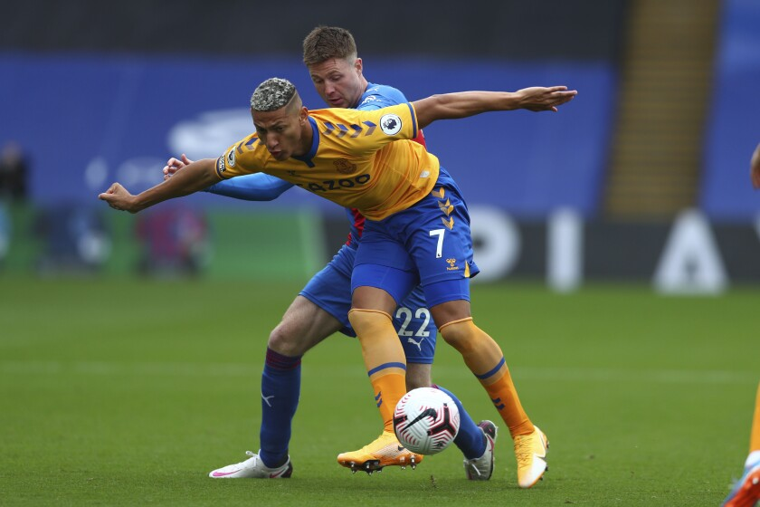 Crystal Palace's James McCarthy, rear fights for the ball with Everton's Richarlison during the English Premier League soccer match between Crystal Palace and Everton, at Selhurst Park, London, Saturday, Sept. 26, 2020. (Clive Rose/Pool via AP)