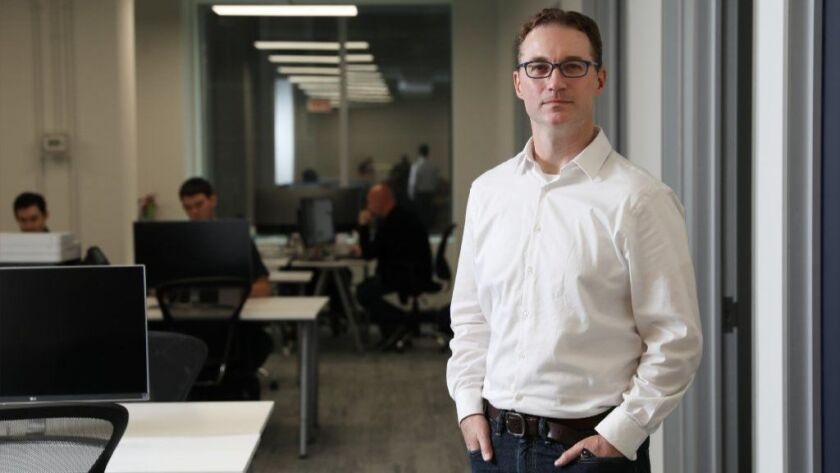 Paul Bauerschmidt, head of Coinbase in Chicago, is seen May 14, 2018 in the company's temporary offices in the Loop. The San Francisco-based company currently has six employees in Chicago but plans to have 30 here by the end of the year and reach 100 within three years.
