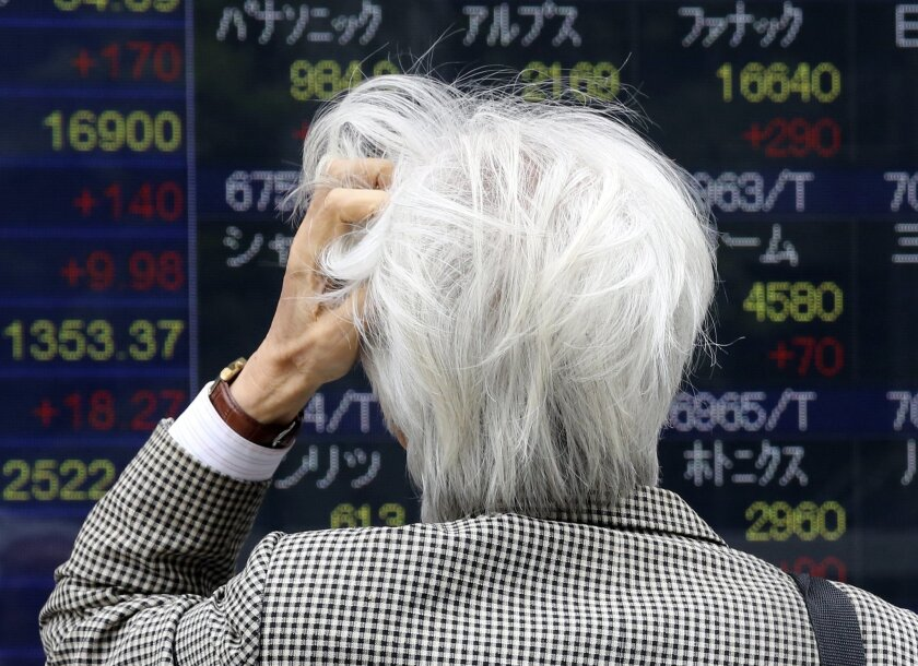 A man looks at an electronic stock board of a securities firm in Tokyo, Monday, May 30, 2016. Asian stocks rose Monday following Wall Street's gains as investors looked ahead to economic data this week from China, Australia and Korea. (AP Photo/Koji Sasahara)