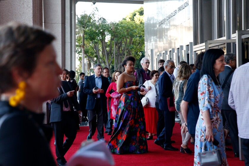 Los Angeles Opera patrons enter the Dorothy Chandler Pavilion on opening night Sept. 14. No protests, and no mention of Placido Domingo in the ball afterward.