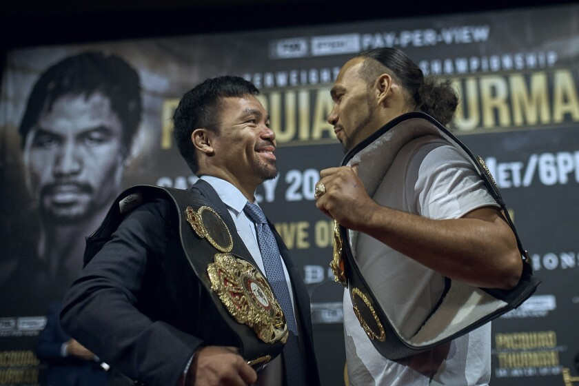 Manny Pacquiao, left, and Keith Thurman stand face to face during a May news conference.