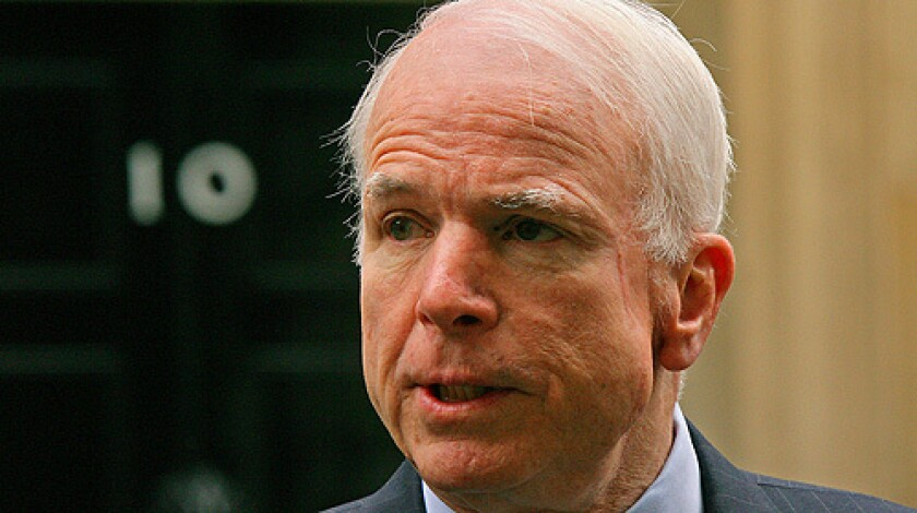 US Republican presidential candidate John McCain addresses the media outside 10 Downing Street in central London, on March 20, 2008, after a meeting with British Prime Minister Gordon Brown. A low-level staffer has been suspended from McCain's campaign in connection with sending out an unauthorized communication.