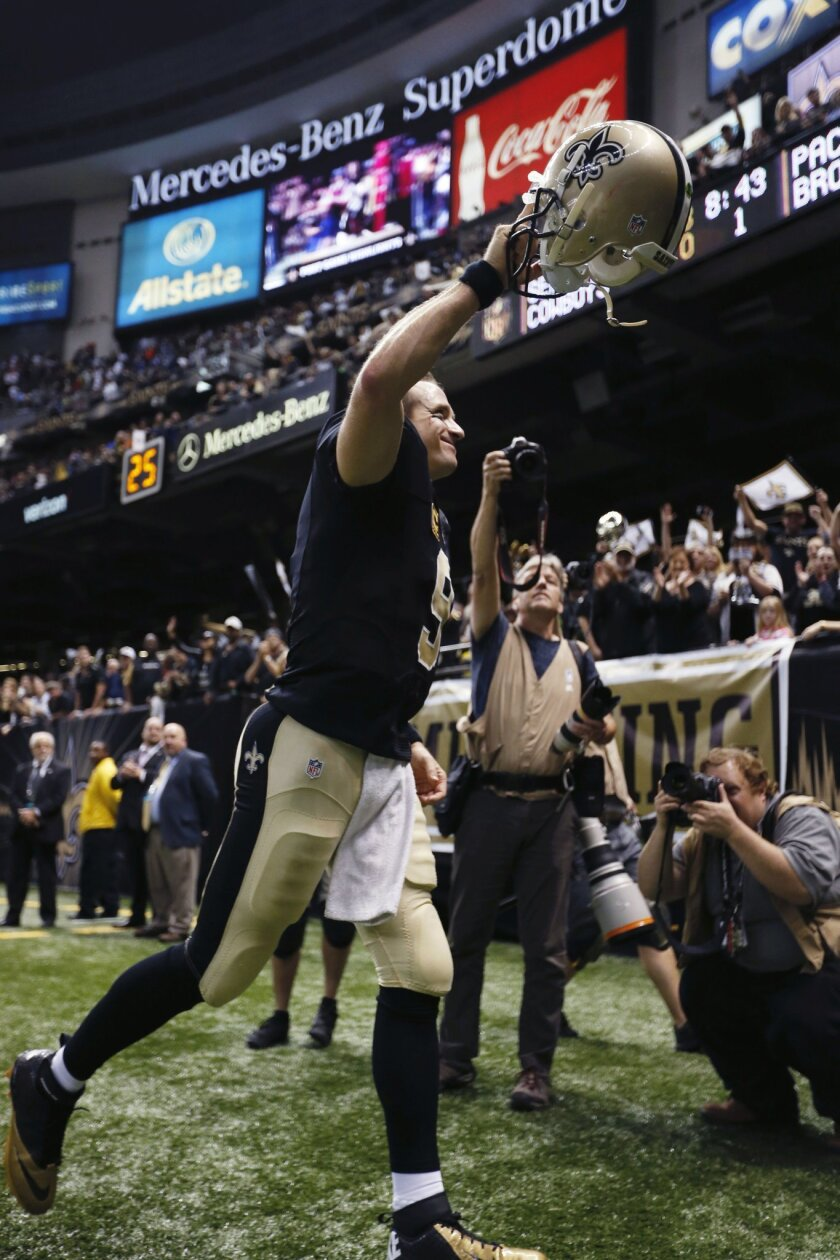 New Orleans Saints quarterback Drew Brees (9) reacts to the crowd as he runs off the field after an NFL football game against the New York Giants in New Orleans, Sunday, Nov. 1, 2015. The Saints won 52-49. (AP Photo/Butch Dill)