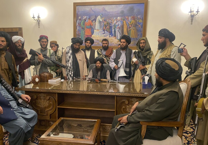 Taliban fighters crowded into the Afghan presidential palace