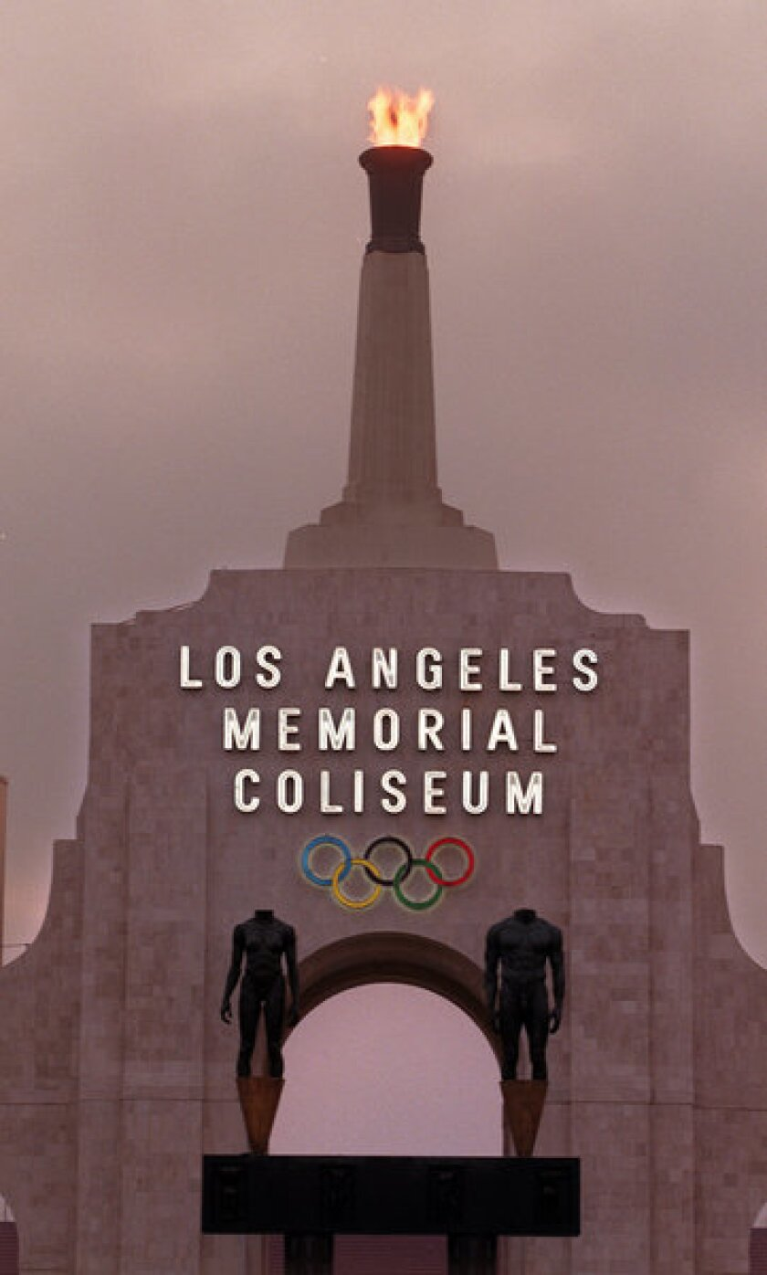 The Coliseum Olympic torch will be lighted to mark the 50th anniversary of President Kennedy's assassination.