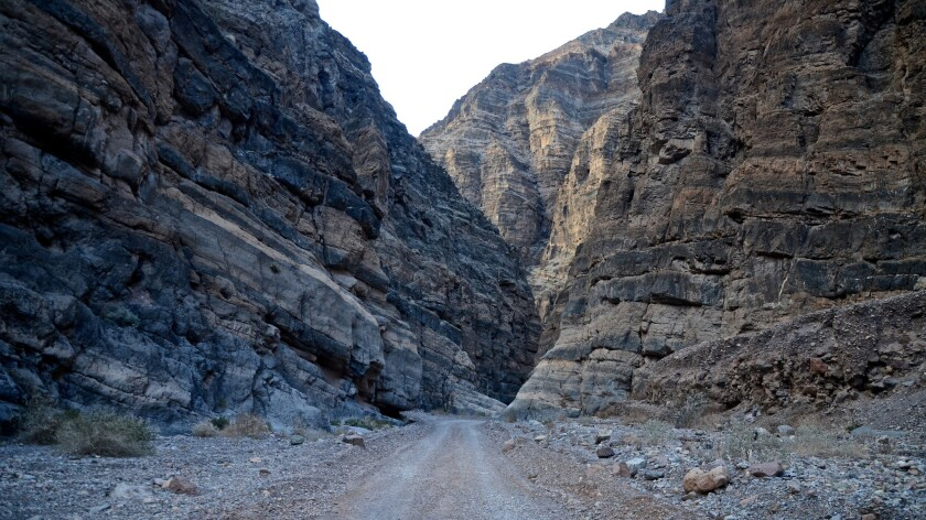 Roads don't get much more rugged than Death Valley's Titus Canyon Road, which features several tight squeezes in narrow canyons and several dramatic switchbacks as well.