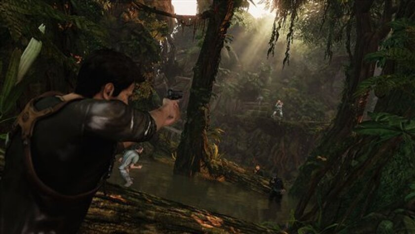 """In this video game image released by Sony, explorer Nathan Drake battles through the jungles of Borneo in a scene from, """"Uncharted 2: Among Thieves."""" (AP Photo/Sony)"""