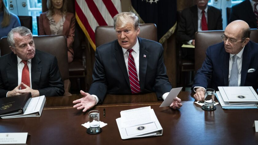 President Trump, shown in a meeting at the White House on Feb. 12, refused to sign a spending bill at the heart of the border fight until the White House counsel's office convinced him it would not stop him from declaring a national emergency, two administration officials said.