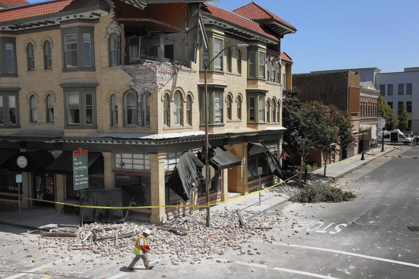 Dan Kavarian, chief building official for the city of Napa, Calif., surveys the damage to buildings in the city's downtown. Inspectors red-flagged at least 15 commercial buildings and 100 homes that were deemed unsafe to enter.