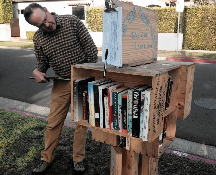 Peter Cook's popular curbside library in West L.A. led to an anonymous complaint and a city crackdown.