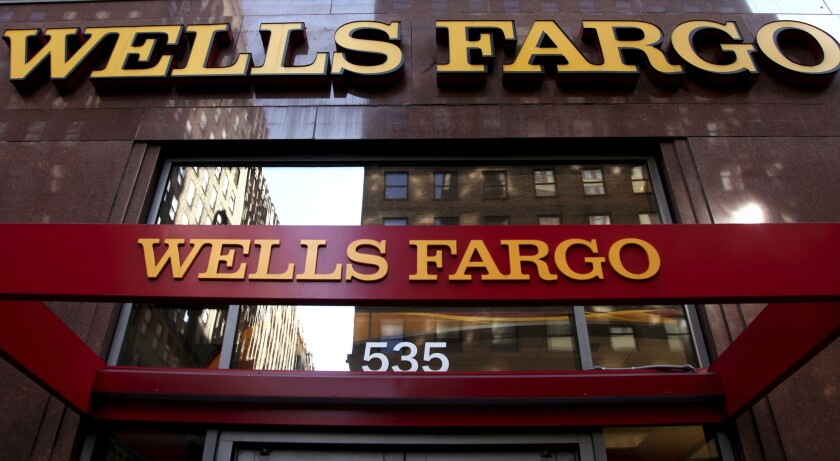 A shareholder advisory firm has recommended Wells Fargo & Co investors vote against most of the company's incumbent board members.