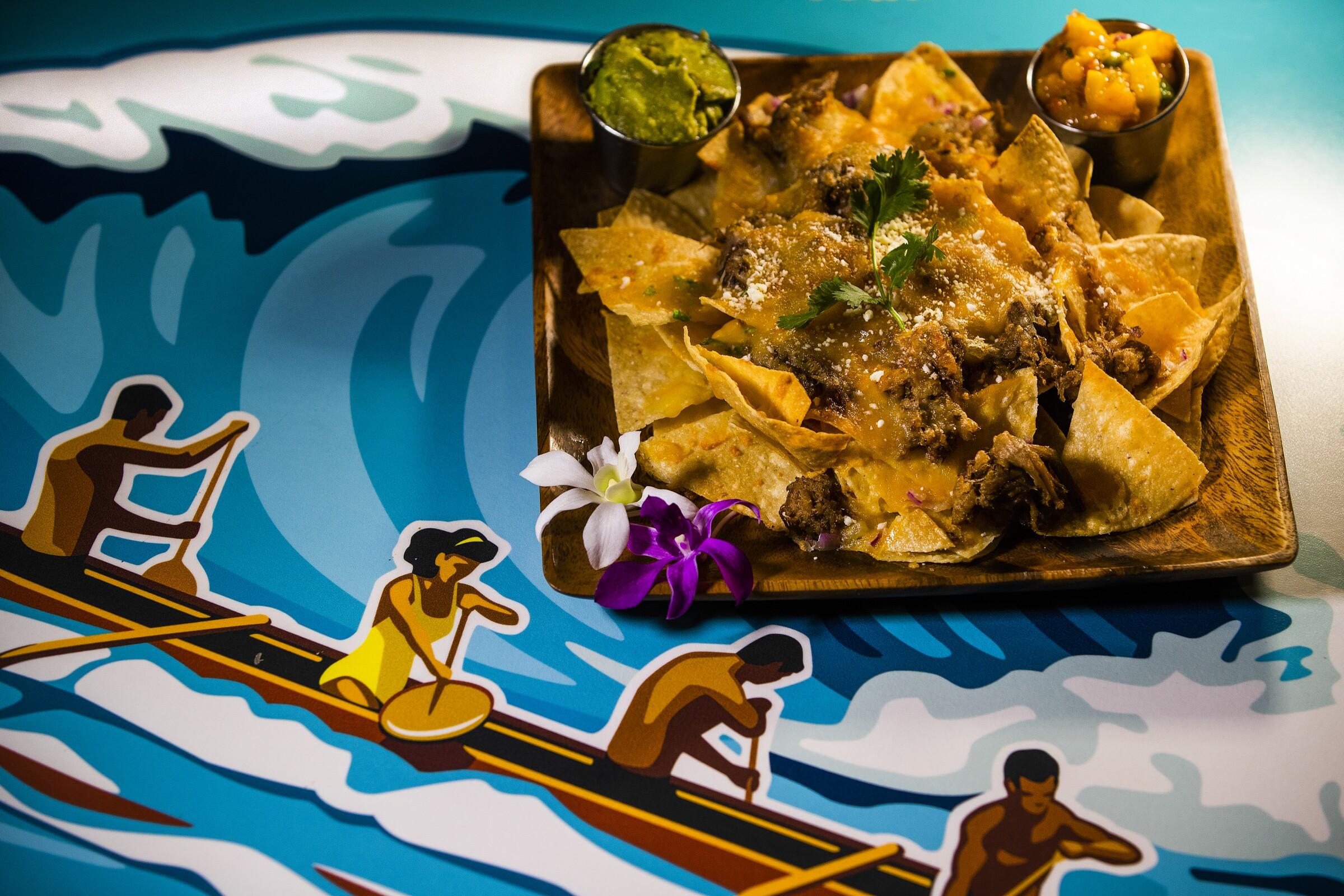 Kalua pork nachos, $19, are on the menu at Kona Tap Room, inside the Hilton Waikoloa Village in Waikoloa Village, Hawaii.