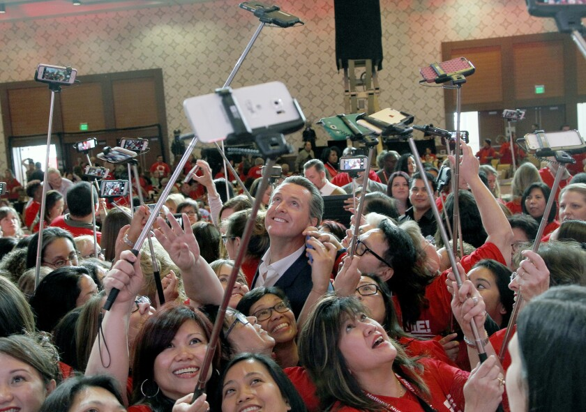 Gavin Newsom, California's lieutenant governor, has his photo taken with registered nurses from California and across the nation in Los Angeles, Wednesday, Dec. 2, 2015. The politically powerful California Nurses Association announced Wednesday that it is endorsing Newsom's bid to become governor nearly three full years before the general election contest. (AP Photo/Nick Ut)