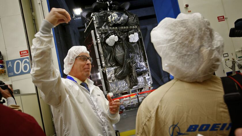At Boeing's satellite building facility in El Segundo, Mark Spiwak talks about a new Inmarsat-5 geostationary communications satellite that stands in a test chamber in 2015.