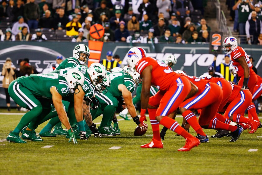 """The New York Jets and the Buffalo Bills line up before a play during their """"Thursday Night Football"""" game at MetLife Stadium on Thursday."""
